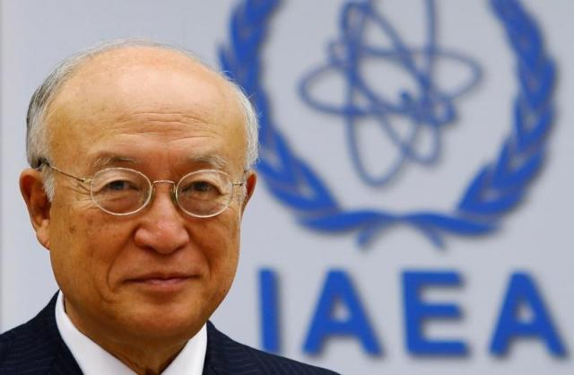IAEA Director General Amano smiles as he waits for a board of governors meeting to begin at the IAEA headquarters in Vienna